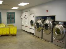Inmate workers work various shifts to ensure all clothing and bedding is washed, dried, and neatly folded for re-issue. The laundry room processes approximately 965,550 pounds of laundry each year.